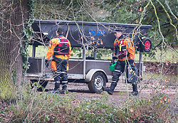 © Licensed to London News Pictures. 05/02/2019. Reading, UK. Police in diving equipment attend to a boat parked next to Whiteknights Lake at Reading University campus in Berkshire after a body was found in the search for missing student Daniel Williams. Daniel has been missing for five days. Photo credit: Peter Macdiarmid/LNP