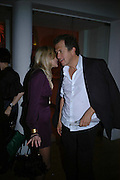OLYMPIA SCARRY AND MARIO TESTINO. Art Plus Music party. Fundraiser for the Whitechapel. 30 March 2006. ONE TIME USE ONLY - DO NOT ARCHIVE  © Copyright Photograph by Dafydd Jones 66 Stockwell Park Rd. London SW9 0DA Tel 020 7733 0108 www.dafjones.com