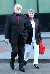 Dave Lee Travis and his wife Marianne Griffin arriving for a hearing to decide if there is to be a re trial at Southwark Crown Court in London, Monday, 24th February 2014. Picture by Stephen Lock / i-Images