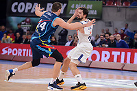 Real Madrid's Sergio Llull and Morabanc Andorra's Oliver Stevic during Quarter Finals match of 2017 King's Cup at Fernando Buesa Arena in Vitoria, Spain. February 16, 2017. (ALTERPHOTOS/BorjaB.Hojas)