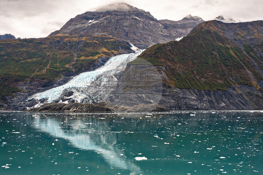 Cascade glacier reflected in the waters of Barry Arm in Harriman Fjord, Prince William Sound near Whittier, Alaska.