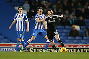 Brentford midfielder Josh McEachran and Brighton central midfielder, Dale Stephens (6) battles for the ball during the Sky Bet Championship match between Brighton and Hove Albion and Brentford at the American Express Community Stadium, Brighton and Hove, England on 5 February 2016.