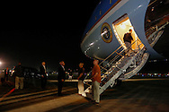 U.S. President Barack Obama boards Air Force One to depart after a surprise night-time visit to address troops at Bagram Air Base in Kabul, May 26, 2014.