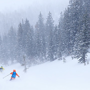Forrest Jillson and Lynsey Dyer ski off into the powder white yonder.