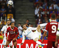 (L-R) Karim Benzema of Real Madrid CF, Virgil van Dijk of Liverpool FC, Gareth Bale of Real Madrid CF scoring 2-1 during the UEFA Champions League final between Real Madrid and Liverpool on May 26, 2018 at NSC Olimpiyskiy Stadium in Kyiv, Ukraine