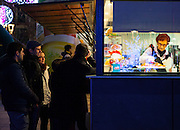 Waiting for Xurros or Churros, at Paca Santa Maria, Puigcerdà, Catalonia, Spain on January  3rd 2015, in the run up to the Epiphany, a major Spanish holiday. (c) Dave Walsh 2015