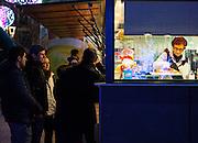 Waiting for Xurros or Churros, at Paca Santa Maria, Puigcerdà, Catalonia, Spain on January  3rd 2015, in the run up to the Epiphany, a major Spanish holiday. (c) Dave Walsh 2015