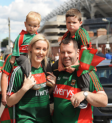 Mayo supporters Lisa and Bernard Guthrie with boys Cuán and Cathal from Ballina<br /> on their way to the Croke park for the All Ireland quarter final replay<br /> Pic Conor McKeown