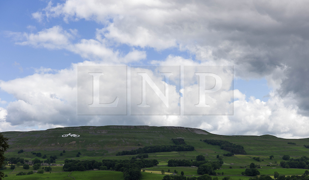 © Licensed to London News Pictures. <br /> 30/06/2014. <br /> <br /> Hawes, Yorkshire<br /> <br /> A large art work in the shape of a bicycle stands out on a hillside outside the market town of Hawes in Yorkshire. The artwork is part of the preparations for the Yorkshire stages of the Tour de France that begins this weekend.<br /> <br /> Photo credit : Ian Forsyth/LNP