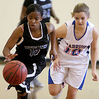 Trask's Jaleah Lee and Alamance's Morgan Cook chase a loose ball during the championship game of the Trask Holiday Tournament. (Jason A. Frizzelle)