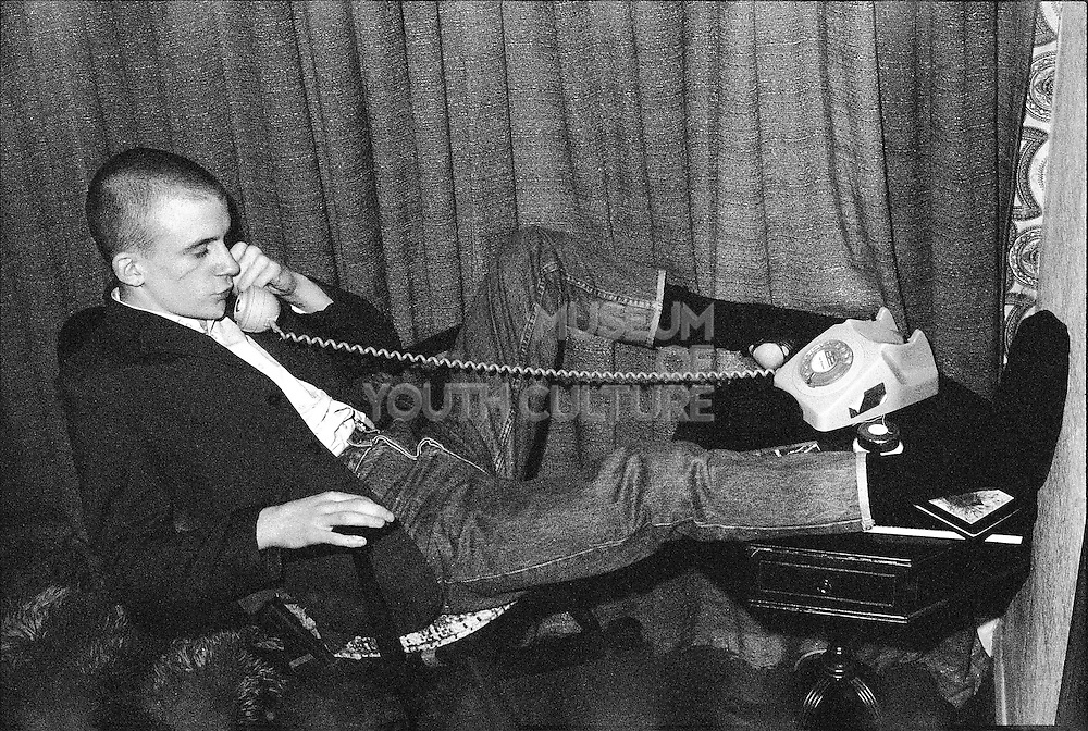 Neville with Scar on Phone, High Wycombe, UK, 1980s.