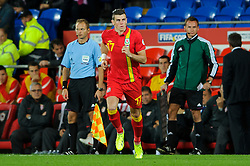 Gareth Bale of Wales (Real Madrid) comeSerbia on off the bench during the second half of the match - Photo mandatory by-line: Rogan Thomson/JMP - Tel: Mobile: 07966 386802 10/09/2013 - SPORT - FOOTBALL - Cardiff City Stadium - Cardiff -  Wales V Serbia- World Cup Qualifier.