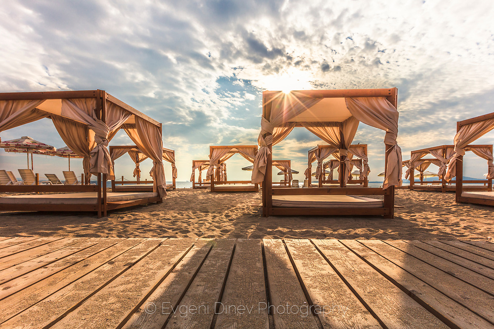 Lounges on the beach at morning time