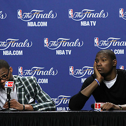 Jun 19, 2012; Miami, FL, USA; Oklahoma City Thunder point guard Russell Westbrook (left) and small forward Kevin Durant (right) talk to the media during the post game press conference after game four in the 2012 NBA Finals against the Miami Heat at the American Airlines Arena. Miami won 104-98. Mandatory Credit: Derick E. Hingle-US PRESSWIRE
