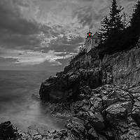 Beacon of Safety features the iconic Bass Harbor Head Light, a picturesque lighthouse located on Mount Desert Island within Maine Acadia National Park on the southeast corner of MDI. The lighthouse towers over the swirling Atlantic Ocean and seacoast, marking the entrance to Bass Harbor and Blue Hill Bay. It is one of the most iconic scenery of Acadia NP as Bass Harbor Light is dramatically located on the edge of rugged cliffs.<br /> <br /> This classic New England lighthouse B&W photography image is available as museum quality photography prints, canvas prints, acrylic prints or metal prints. Fine art prints may be framed and matted to the individual liking and decorating needs:<br /> <br /> http://juergen-roth.pixels.com/featured/beacon-of-safety-juergen-roth.html<br /> <br /> Good light and happy photo making! <br /> <br /> My best, <br /> <br /> Juergen<br /> Website: www.RothGalleries.com<br /> Twitter: @NatureFineArt<br /> Facebook: https://www.facebook.com/naturefineart<br /> Instagram: https://www.instagram.com/rothgalleries
