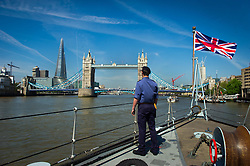 © Licensed to London News Pictures. 30/05/2012 London, UK. HMS Hurworth arrives in London ahead of the Queen's  Jubilee celebrations.  The Royal Navy mine sweeper will form part of the ceremonial detail for the Diamond Jubilee Pageant. Photo credit : Simon Jacobs/LNP
