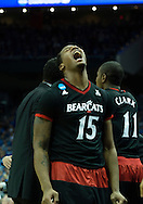 21 MAR 2015: Jermaine Saunders (15) of University of Cincinnati celebrates a call against University of Kentucky during the 2015 NCAA Men's Basketball Tournament held at the KFC Yum! Center in Louisville, KY. Kentucky defeated Cincinnati 64-51. Brett Wilhelm/NCAA Photos