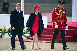 © London News Pictures 20/10/2015. Prime Minister David Cameron, Teresa May and Lieutenant Colonel, Sir Andrew Ford.<br /> <br /> More than 1,100 soldiers and 230 horses joined HM The Queen, HRH The Duke of Edinburgh, The Duke and Duchess of Cornwall, the Prime Minister, Senior members of the Cabinet, the Lord Mayor of London, the Mayor of London, and the Defence Chiefs of Staff for the ceremonial welcome to Britain of The President of The People's Republic of China and Madame Peng Liyuan . Photo credit: Rupert Frere/LNP