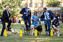 © Licensed to London News Pictures. 08/09/2016. London, UK. MPs perform their skills with their dog as they take part in Westminster Dog of the Year competition in Victoria Tower Gardens, London on Thursday, 8 September 2016. Photo credit: Tolga Akmen/LNP