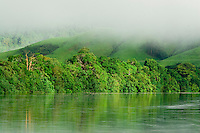 Early morning mists over the Daintree River in far north Queensland.