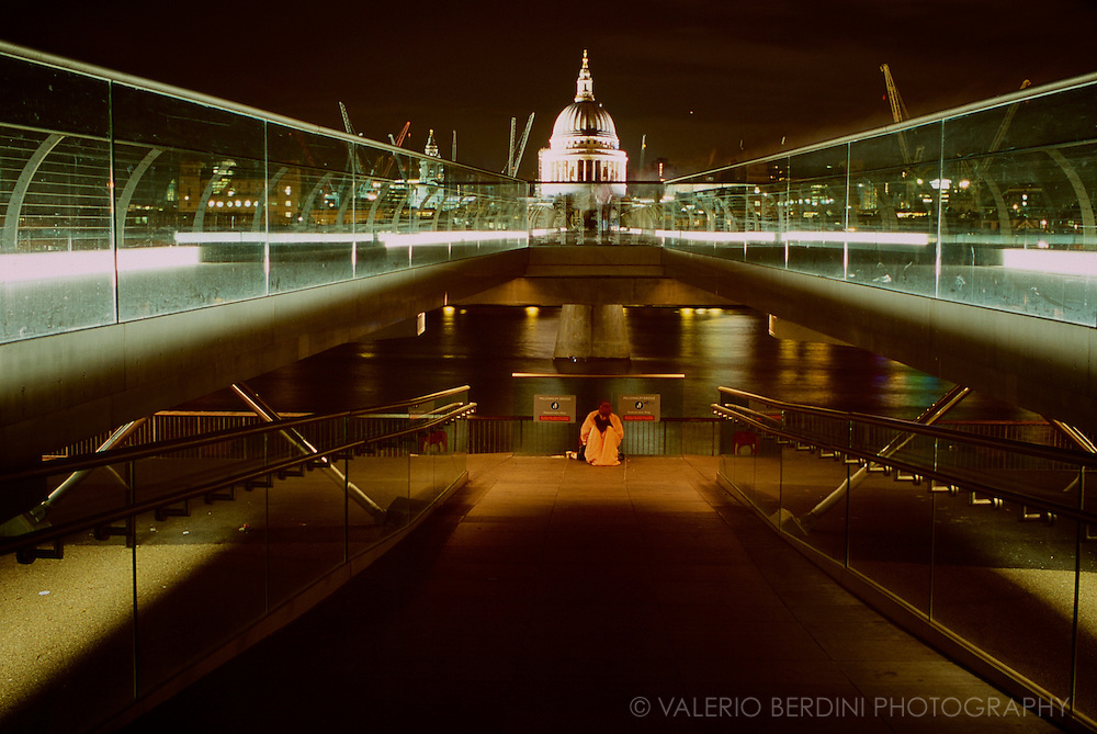 A beggar on the Millennium Bridge in London shot on 35mm slide from the Tate Modern side on an early night around 2003-ish.