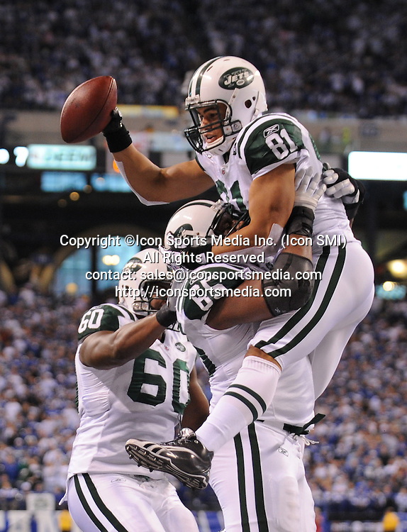 January 24, 2010: New York Jets at Indianapolis Colts AFC Championship game at Lucas Oil Stadium in Indianapolis, IN: New York Jets Dustin Keller (top) is lifted up by teammates Brandon Moore (C)  and D'Brickashaw Ferguson for a touchdown in the second quarter of the AFC Championship game. PHOTO BY:Anthony J. Causi