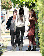 21.MAY.2011. LOS ANGELES<br /> <br /> RUMER WILLIS LAUGHING AND DANCING WITH CO-WORKERS OUTSIDE OF HER MOVIE TRAILER IN LOS ANGELES. RUMER WAS WEARING A LONG RED DRESS TO MATCH HER HAIR WITH BLACK ARMY BOOTS. IT LOOKS LIKE RUMER MIGHT HAVE A LITTLE PREGNANY BABY BUMP WHILE SMOKING A CIGARETTE.<br /> <br /> BYLINE: EDBIMAGEARCHIVE.COM<br /> <br /> *THIS IMAGE IS STRICTLY FOR UK NEWSPAPERS AND MAGAZINES ONLY*<br /> *FOR WORLD WIDE SALES AND WEB USE PLEASE CONTACT EDBIMAGEARCHIVE - 0208 954 5968*
