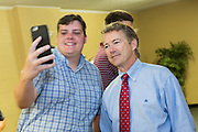 Senator and GOP presidential candidate Rand Paul takes a selfie with a supporter at the Veterans of Foreign Wars post June 15, 2015 in Lexington, South Carolina. Paul told the crowd that the country is suffering from Bush-Clinton fatigue.
