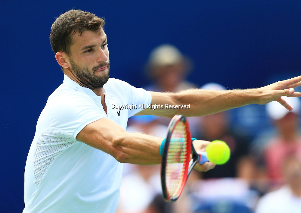 29.07.2016. Toronto, ONT, Canada.  Grigor Dimitrov of Bulgaria returns the ball against Kei Nishikori of Japan during their quarterfinal match of men's singles at the 2016 Rogers Cup in Toronto, Canada, July 29, 2016. Grigor Dimitrov lost 1-2.