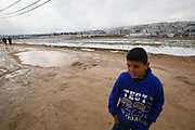 A Syrian refugee boy walks amongst snow and mud an informal tented settlement in Lebanon's Bekaa valley, 30 January 2017.<br /> <br /> Picture: Russell Watkins/DFID