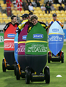 Players participate in a segway race during the State Twenty20 uniform launch held during the break in innings at the first Twenty20 match between the New Zealand Black Caps and Sri Lanka held at Westpac Stadium in Wellington, New Zealand on Friday, 22 December 2006. Sri Lanka won the match on Duckworth Lewis calculations. Photo: Tim Hales/PHOTOSPORT