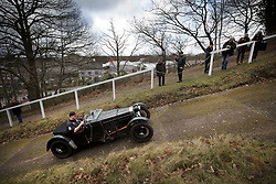 © Licensed to London News Pictures. 28/01/2018. Weybridge, UK. A competitor tackles the steepest gradient of the hill test at Brooklands Museum during The Vintage Sports-Car Club's New Year driving tests.  Photo credit: Peter Macdiarmid/LNP