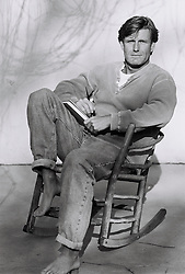 man sitting on rocking chair, portrait (B&W)