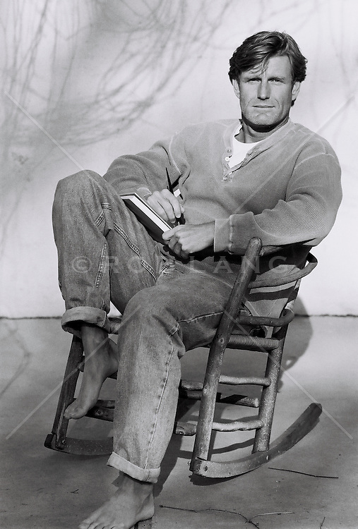 man sitting on rocking chair, portrait (B&W)