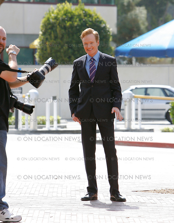 LOS ANGELES, CALIFORNIA - THURSDAY 25TH MARCH 2009 **EXCLUSIVE** Conan O'Brien poses for a photo shoot for NBC Television in front of the famous Union Station in Downtown Los Angeles. Conan will take over from Jay Leno as the new host of The Tonight Show starting on June 1st 2009. Sales: Eric Ford 1/818-613-3955 info@onlocationnews.com