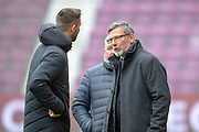 Hearts new signing David Vanecek (#32)(left) chats with Craig Levein, manager of Heart of Midlothian before the 4th round of the William Hill Scottish Cup match between Heart of Midlothian and Livingston at Tynecastle Stadium, Edinburgh, Scotland on 20 January 2019.