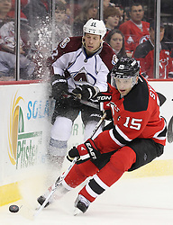 Mar 15; Newark, NJ, USA; New Jersey Devils right wing Petr Sykora (15) plays the puck away from Colorado Avalanche defenseman Matt Hunwick (22) during the second period at the Prudential Center.