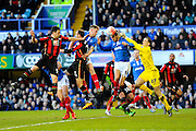 Portsmouth's Ryan Fulton attempts to punch the ball clear during a Bournemouth attack in the The FA Cup fourth round match between Portsmouth and Bournemouth at Fratton Park, Portsmouth, England on 30 January 2016. Photo by Graham Hunt.