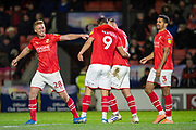 Swindon Town celebrate as Jerry Yates of Swindon Town scores to make it 0-3 during the EFL Sky Bet League 2 match between Grimsby Town FC and Swindon Town at Blundell Park, Grimsby, United Kingdom on 7 December 2019.