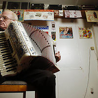 -<br /> <br /> -Dick Moles plays his accordion at his appliance store on State Street NE on Wednesday Feb. 2, 2005. He will be playing at Historic Deepwood Estate &quot;Evening Paris&quot; on Feb. 12. Photo by Timothy J. Gonzalez