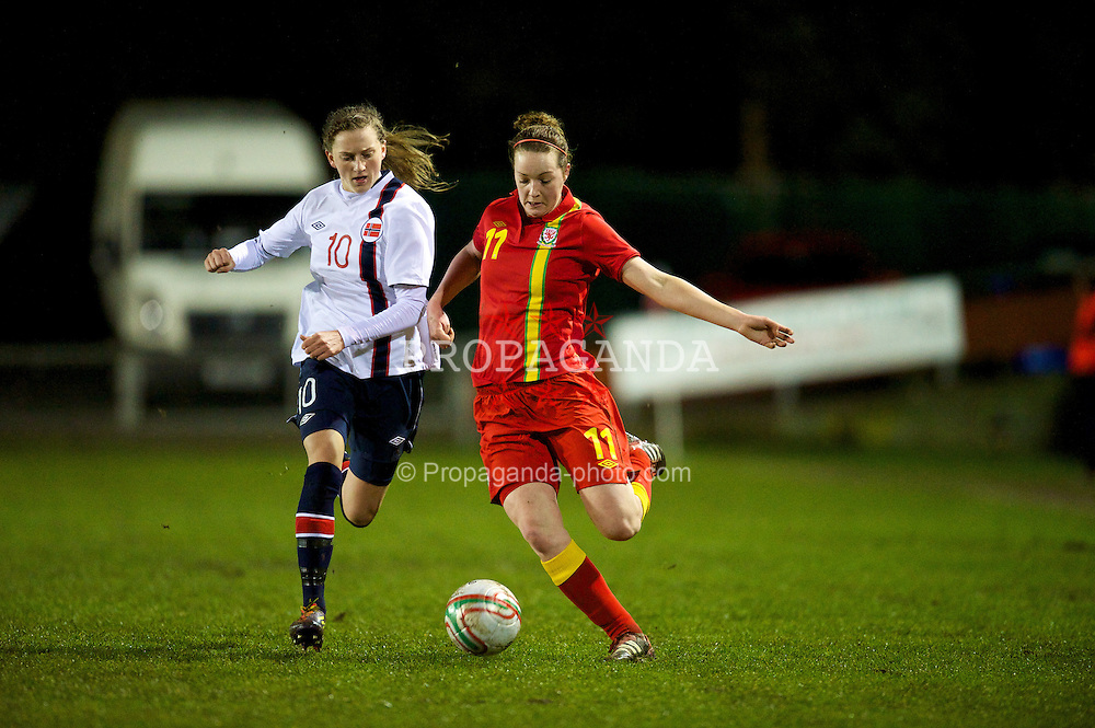 NEWTOWN, WALES - Friday, February 1, 2013: Wales' Samanthan Quayle in action against Norway's Andrea Thun during the Women's Under-19 International Friendly match at Latham Park. (Pic by David Rawcliffe/Propaganda)