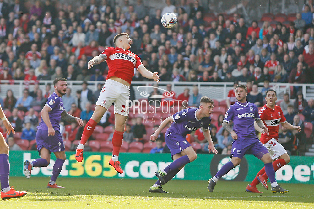Middlesbrough forward Jordan Hugill (11) rises to head a cross during the EFL Sky Bet Championship match between Middlesbrough and Stoke City at the Riverside Stadium, Middlesbrough, England on 19 April 2019.