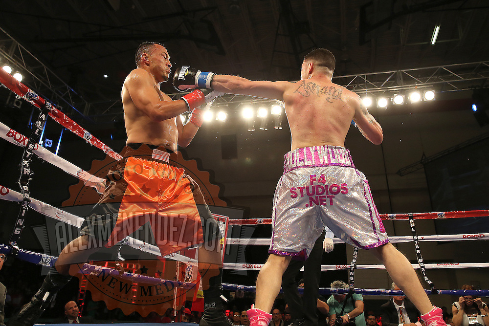 KISSIMMEE, FL - MARCH 06:  Charles Natal (R) throws a jab to the face of Juan Aguirre during the Telemundo Boxeo boxing match at the Kissimmee Civic Center on March 6, 2015 in Kissimmee, Florida. (Photo by Alex Menendez/Getty Images) *** Local Caption ***  Charles Natal; Juan Aguirre