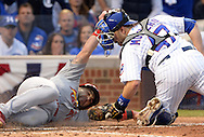 CHICAGO, IL - OCTOBER 12:  Miguel Montero #47 of the Chicago Cubs tags out a sliding Tony Cruz #48 to end the sixth inning during Game 3 of the NLDS against the St. Louis Cardinals at Wrigley Field on Monday, October 12, 2015 in Chicago , Illinois. (Photo by Ron Vesely/MLB Photos via Getty Images) *** Local Caption *** Miguel Montero