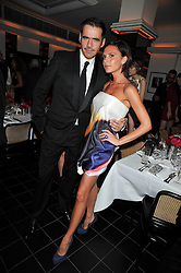 ROLAND MOURET and VICTORIA BECKHAM at a dinner hosted by Alexandra Shulman editor of British Vogue in association with Net-A-Porter.com to celebrate 25 years of London Fashion Week and Nick Knight held at Le Caprice, Arlington Street, London on 21st September 2009.