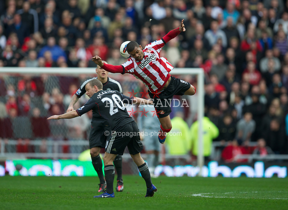 SUNDERLAND, ENGLAND - Saturday, March 10, 2012: Liverpool's Jay Spearing and Sunderland's Fraizer Campbell during the Premiership match at the Stadium of Light. (Pic by David Rawcliffe/Propaganda)
