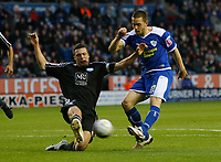 Photo: Steve Bond/Richard Lane Photography. Leicester City v Peterborough United. Coca-Cola Football League One. 20/12/2008. Matty Fryatt (R) shoots as Russell Martin (L) tries to block