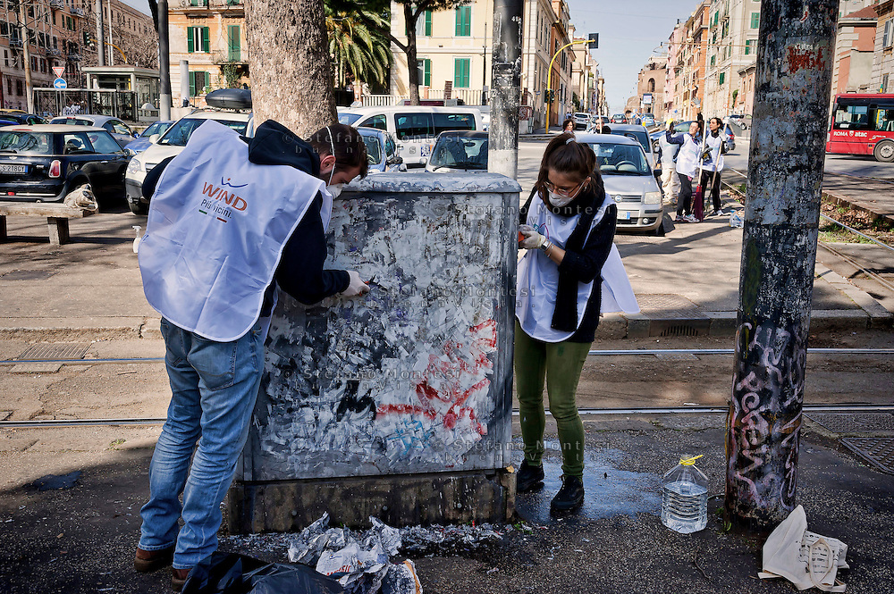 "Volunteers clean the archaeological area of Porta Maggiore.<br /> ""Wake up Roma ', the great collective mobilization promoted by Retake and Luiss EnLabs for the decorum of the city against the deterioration and abandonment. About three thousand volunteers with scrapers and brushes in hand they removed posters and stickers, clean walls and poles, they cleaned up gardens and flower beds, driveways and sidewalks. Interventions to Piazza Vittorio, Porta Maggiore, Villa Paganini and place Anco Marzio in Ostia. Rome, Italy 12th March 2016"