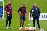 England forward Harry Kane looks unimpressed as manager Roy Hodgson issues out instructions during the England Training Session at St George's Park National Football Centre, Burton-Upon-Trent, United Kingdom on 7 October 2015. Photo by Aaron Lupton.