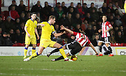 Leeds United defender and captain Liam Cooper tackling Brentford striker Lasse Vibe during the Sky Bet Championship match between Brentford and Leeds United at Griffin Park, London, England on 26 January 2016. Photo by Matthew Redman.